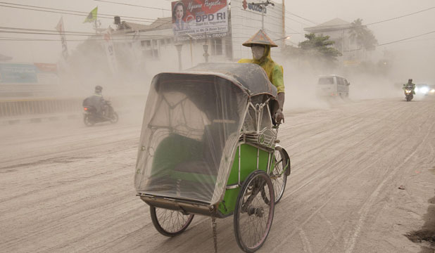 SMOTHERING: A Yogyakarta road is smothered in debris from Mount Kelud, which  erupted on the heavily populated Indonesian island of Java.
