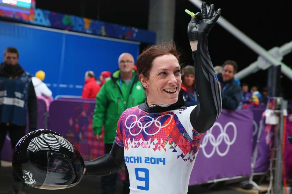 Katharine Eustace waves to the crowd after her third run during the women's skeleton at the Sanki Sliding Center.