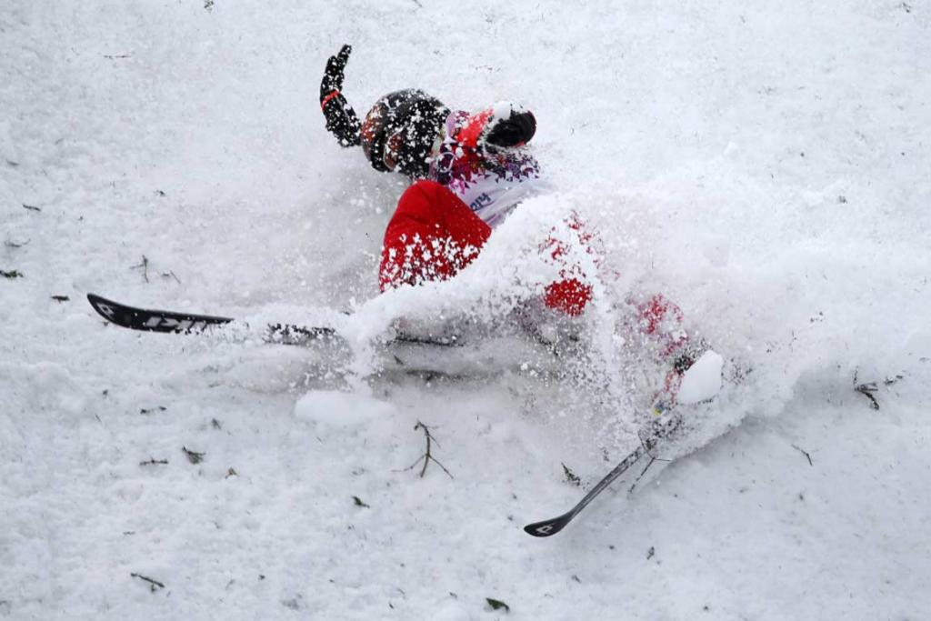 China's Zhang Xin crashes during the women's aerials qualifying.