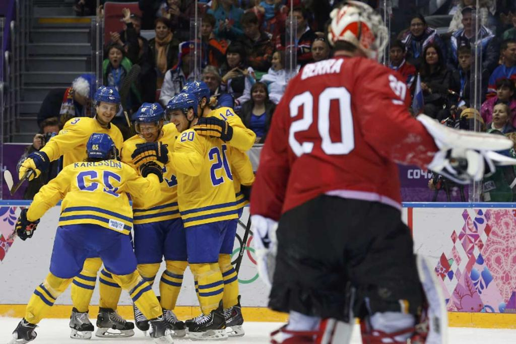 Daniel Alfredsson celebrates his game-winning goal in Sweden's 1-0 win against Switzerland.