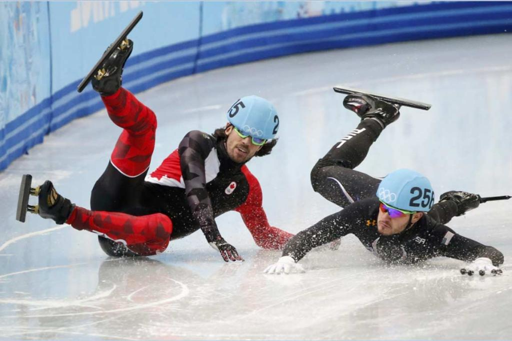 Canada's Charles Hamelin (left) and USA's Eduardo Alvarez crash out of the men's 1000m short track speed skating event.