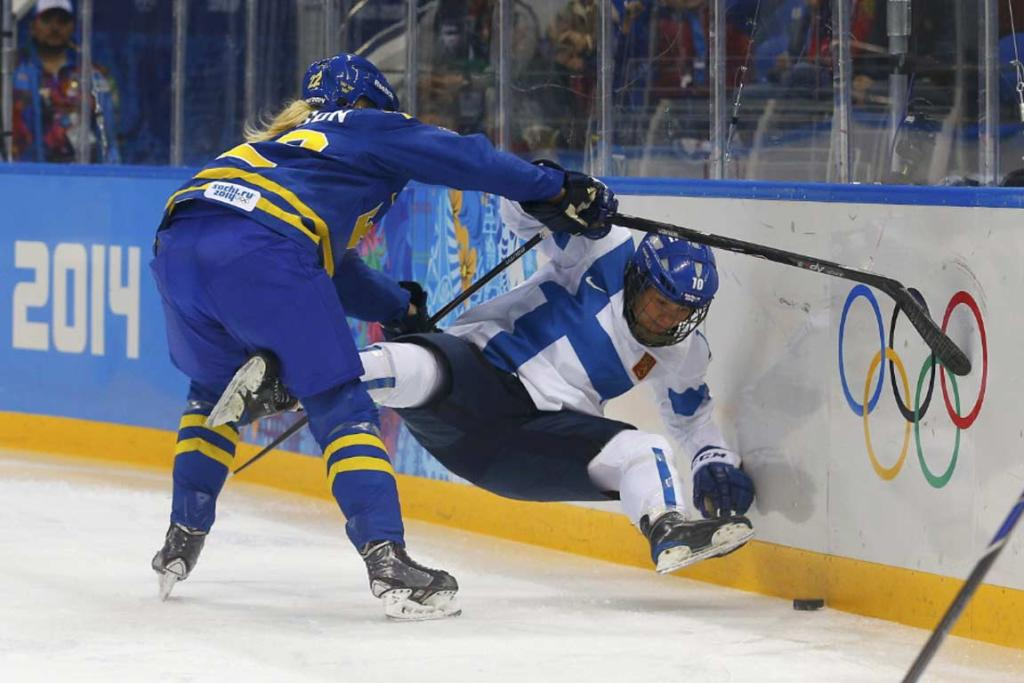 Sweden's Emma Eliasson shoves Finland's Linda Valimaki into the boards during their preliminary round game.