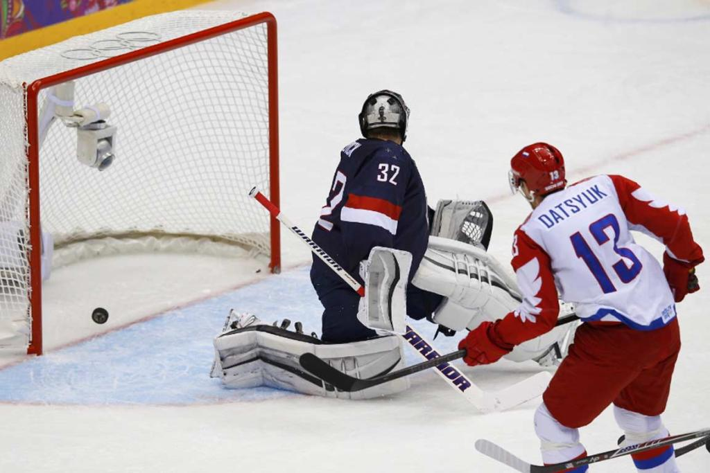 Russian captain Pavel Datsyuk sneaks the puck by USA goalie Jonathan Quick during the second period of their game.