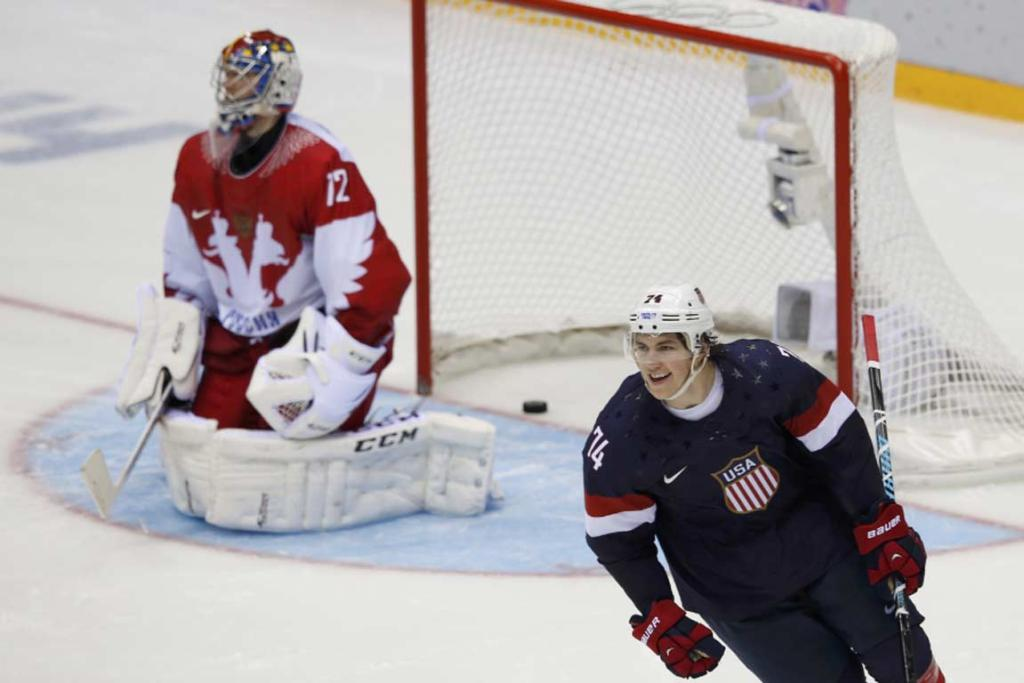 USA's TJ Oshie celebrates his game-winning goal against Russia's Sergei Bobrovski in the eighth round of the shootout.