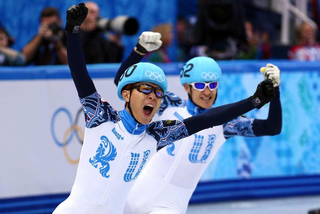 Viktor Ahn and Vladimir Grigorev celebrate a Russian 1-2 in the men's 1000m short track race.