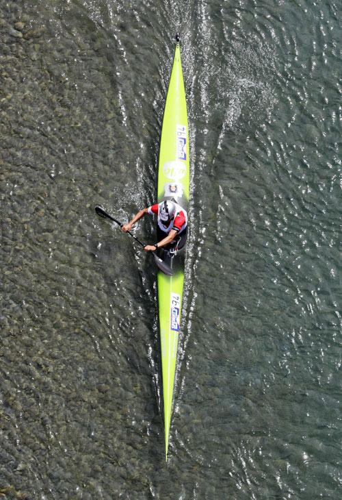 WAIMAK: Coast to Coast One Day.  Braden Currie coming in to end of Kayak section at Waimakariri Gorge Bridge.