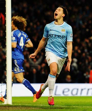 HEAVYWEIGHT VICTORY: Samir Nasri celebrates after scoring in Manchester City's 2-0 victory over Chelsea in the FA Cup fifth round.