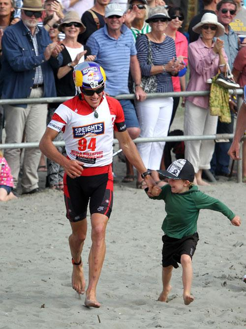GOT YOU DAD: Finish of the annual Speights Coast to Coast Race at Sumner Beach. Winner of the One Day race was Braden Currie. Braden's son, Tarn, 5, was with dad at the finish line.