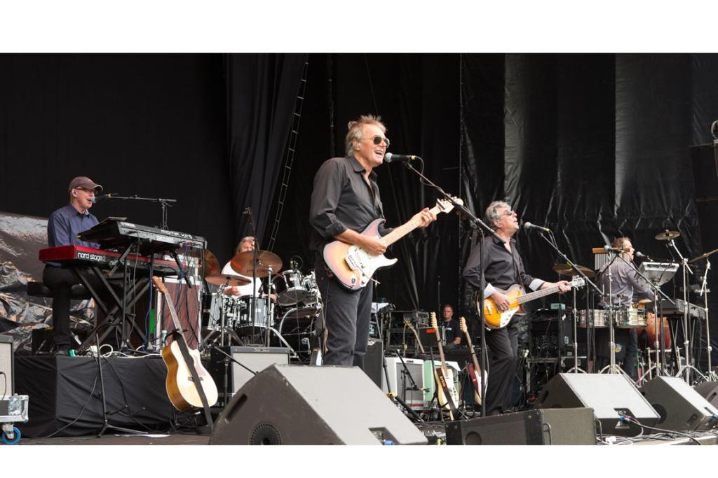 Guitarist Rick Fenn, centre, and 10cc in action.