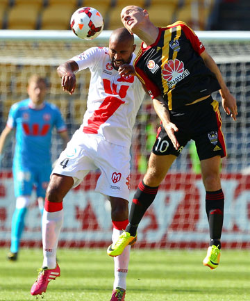 AIRBORNE: Orlando Engelaar of the Heart and Stein Huysegems of the Phoenix compete for a header during the A-League match.