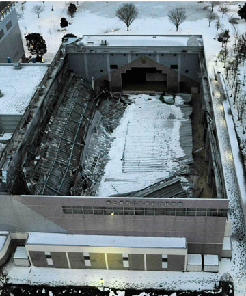 NO CASUALTIES: A general view of the collapsed roof of a public gymnasium is seen in Fujimino, north of Tokyo.