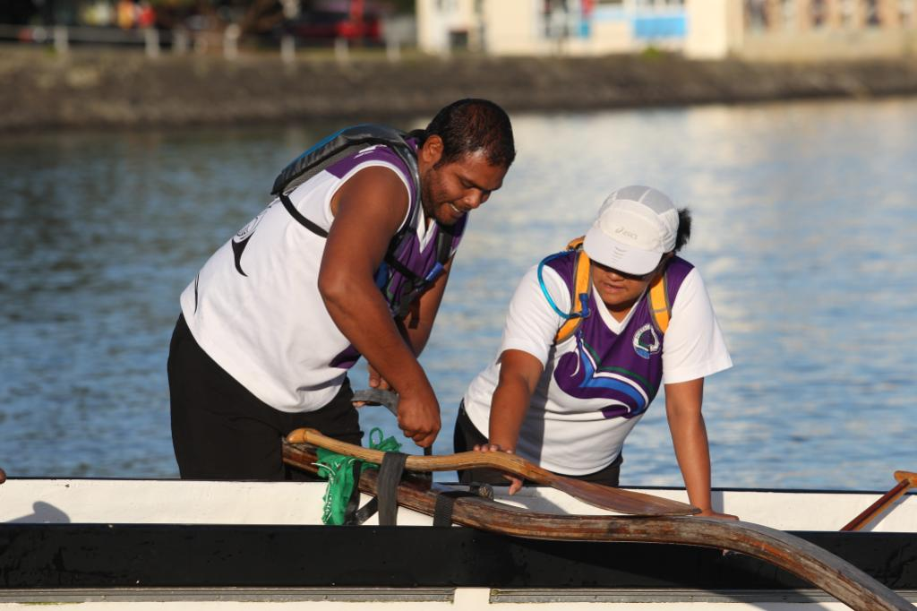 Fareed Razak (left) and Claudine Nathan from team Portage Crossing prepare their waka.