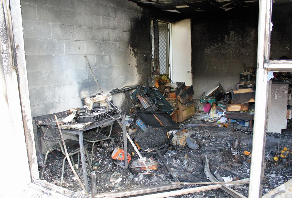 GUTTED: The inside of this Housing NZ flat in Birkenhead is barely recognisable after fire tore through it last night.