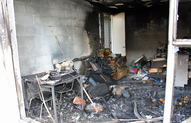 GUTTED: The living room of this one bedroom flat in Birkenhead, Auckland has been destroyed by fire.