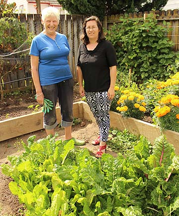 PROMOTING HEALTH: Volunteer Dorothy Cooper, left, and Te Whare Marama o Mangere Refuge co-ordinator Christina Teikamata are teaching residents easy and sustainable ways for healthier living by offering gardening and cooking classes.