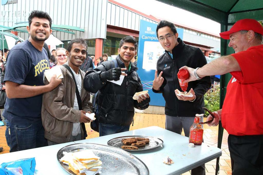 Pictured on day one of SIT O Week 2014 getting their free sausages from Murray Heath on the Westpac barbecue are, from left, Jomy Joseph, Tharaka Liyanapathirana, Rajesh Bhavard and Jeffrey Tan.