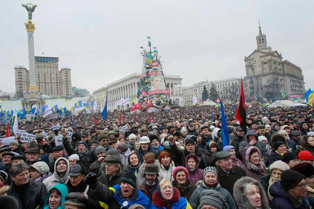 Anti-government protesters attend a rally at Independence Square in Kiev on February 16.
