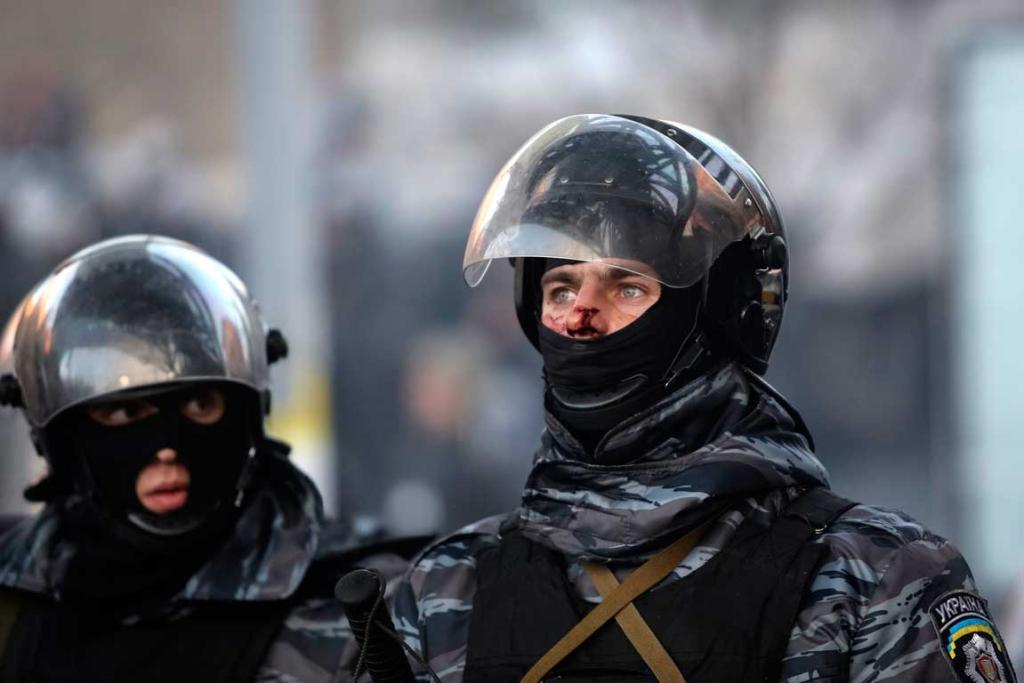 A wounded riot police officer is seen in central Kiev.