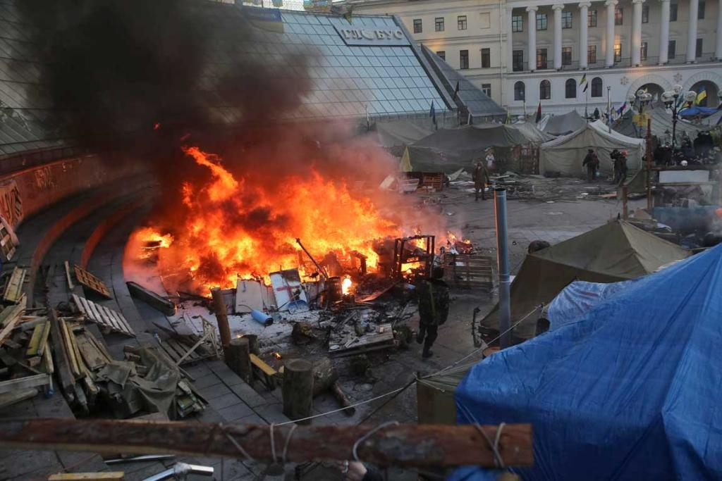 A tent burns in the anti-government protesters camp at Independence Square in Kiev.