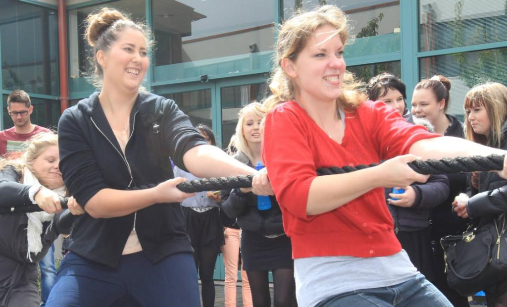 Alison Blair, Sharna Adolphe and Rachel Rajwer attempt to win a tug-of-war competition at the Southern Institute of Technology's O Week 2014.