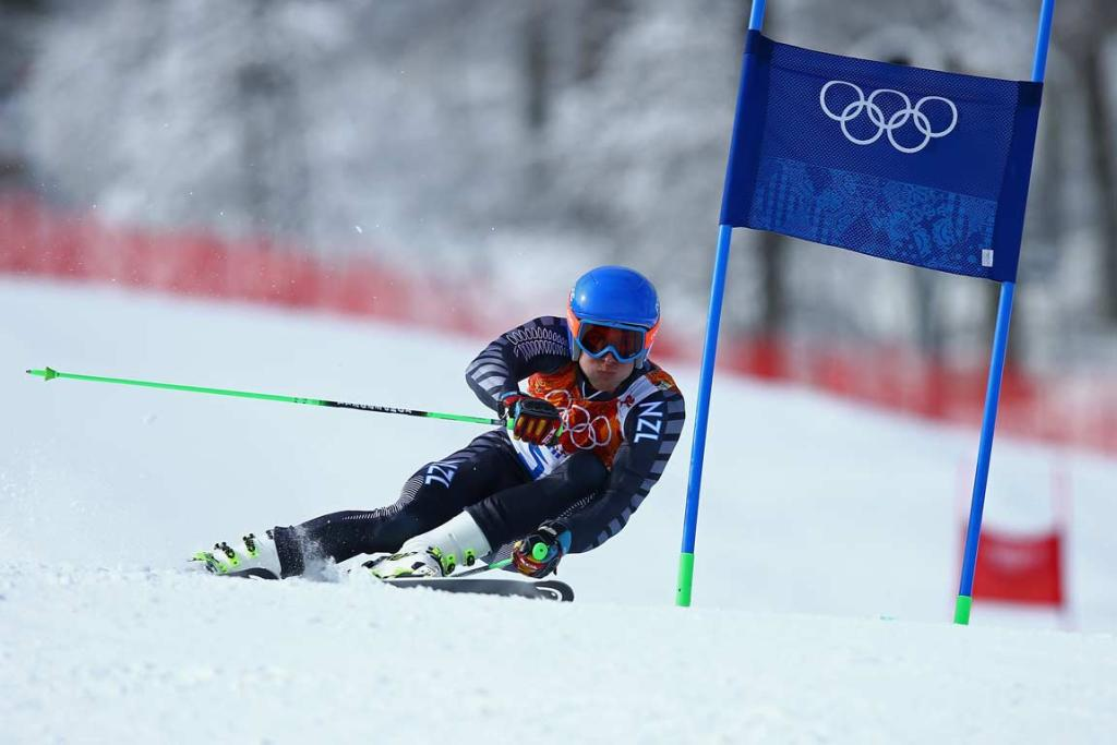 New Zealand's Adam Barwood brushes by a gate during one of his giant slalom runs.