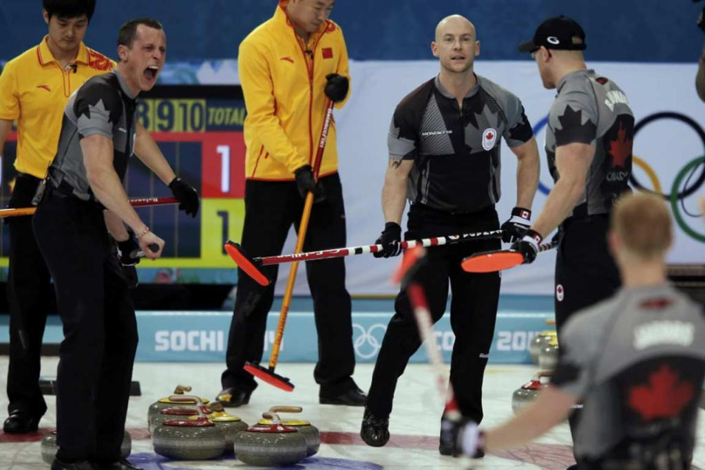 Canada's second EJ Harnden shouts as China's third Xu Xiaoming (left) and skip Liu Rui (right) look on and Canada's vice Ryan Fry and lead Ryan Harnden stand nearby during their men's curling semifinal game.