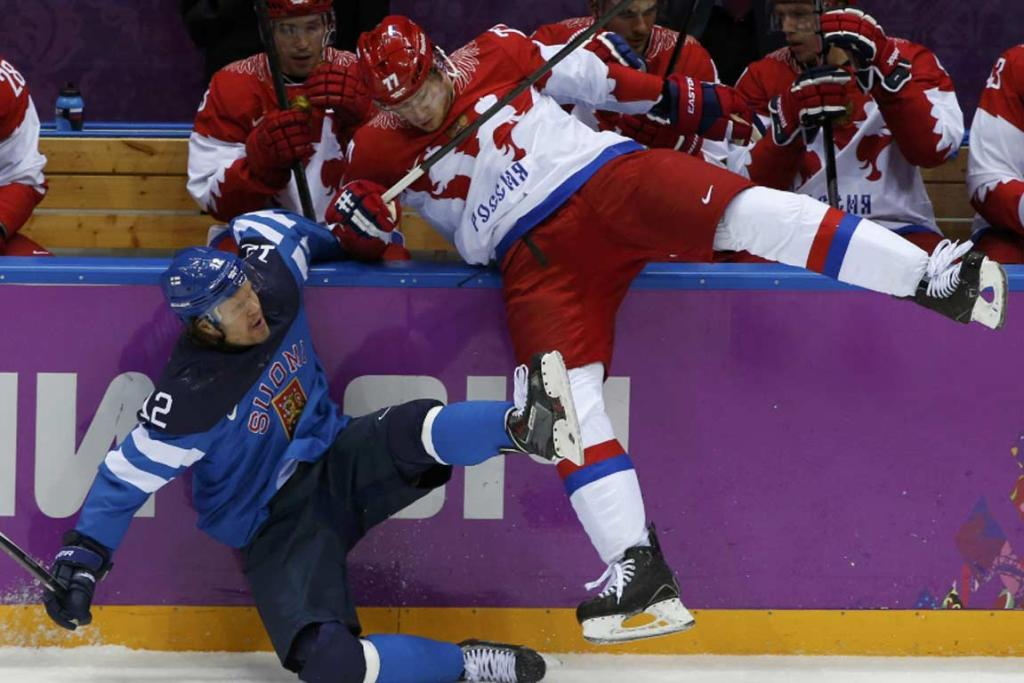 Russia's Anton Belov (right) checks Finland's Olli Jokinen during the first period of their men's ice hockey quarterfinal.