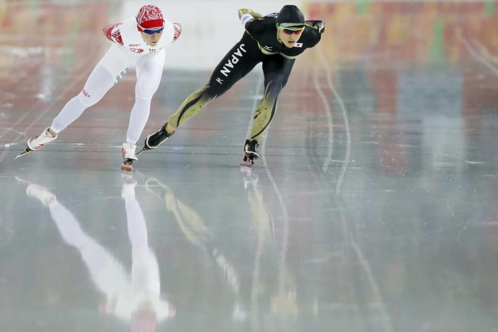Russia's Olga Graf (left) and Japan's Shiho Ishizawa skate during the women's 5000 metres speed skating finals.