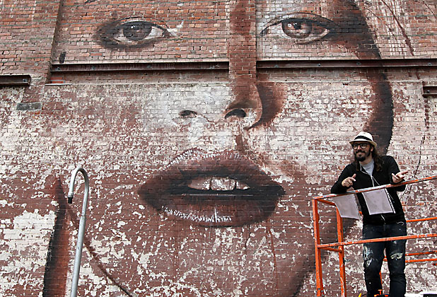 NEW SPACES: Australian street artist Rone would not have had access to this large brick canvas pre-quake.