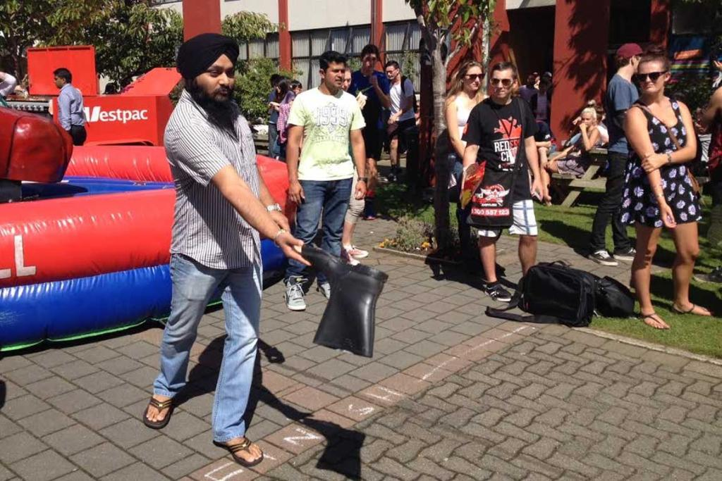 Kuldeep Singh tries his luck at the gumboot-throwing contest at SIT O Week 2014.