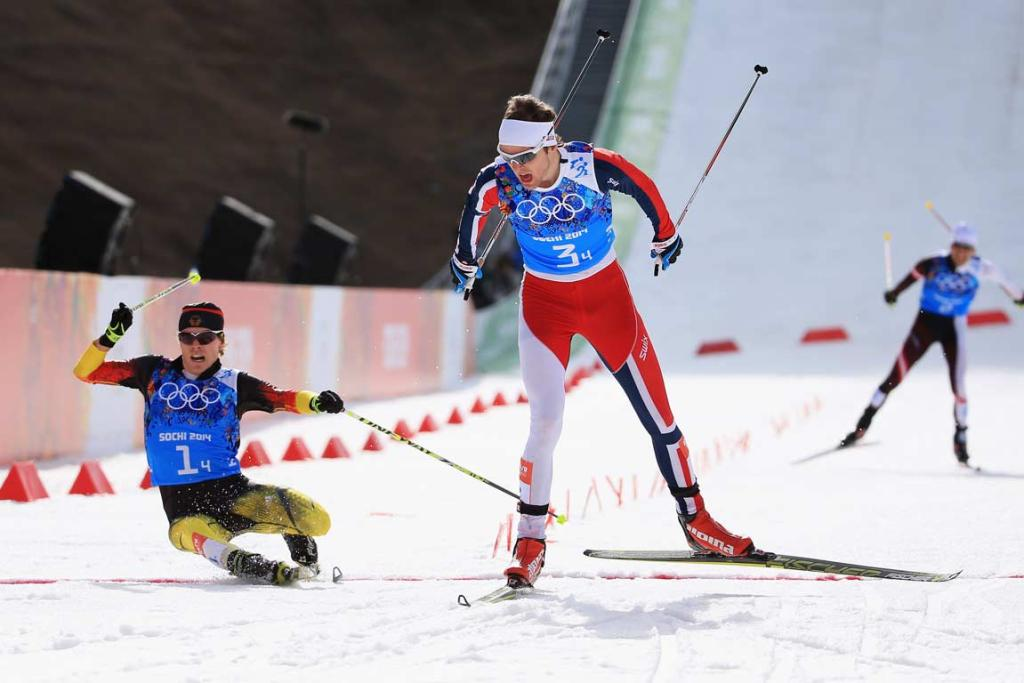 Norway's Joergen Graabak holds off German Fabian Riessle's desperate lunge at the finish line to win the men's team large hill nordic combined 4x5km relay event.