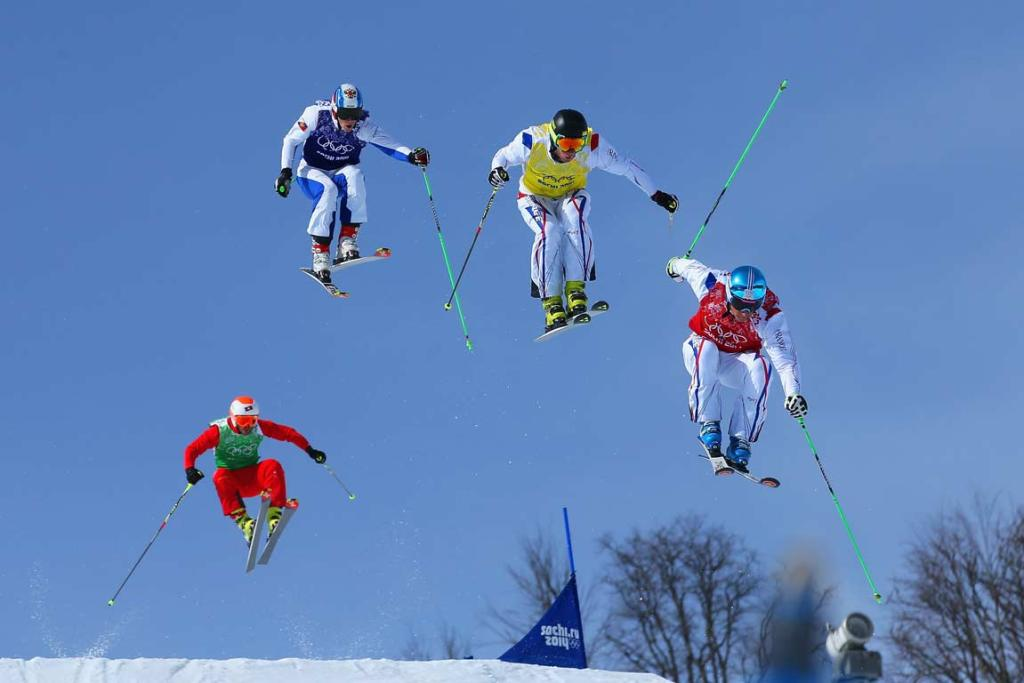 Eventual gold medalist Jean Frederic Chapuis of France (yellow) leads in his ski-cross semifinal.