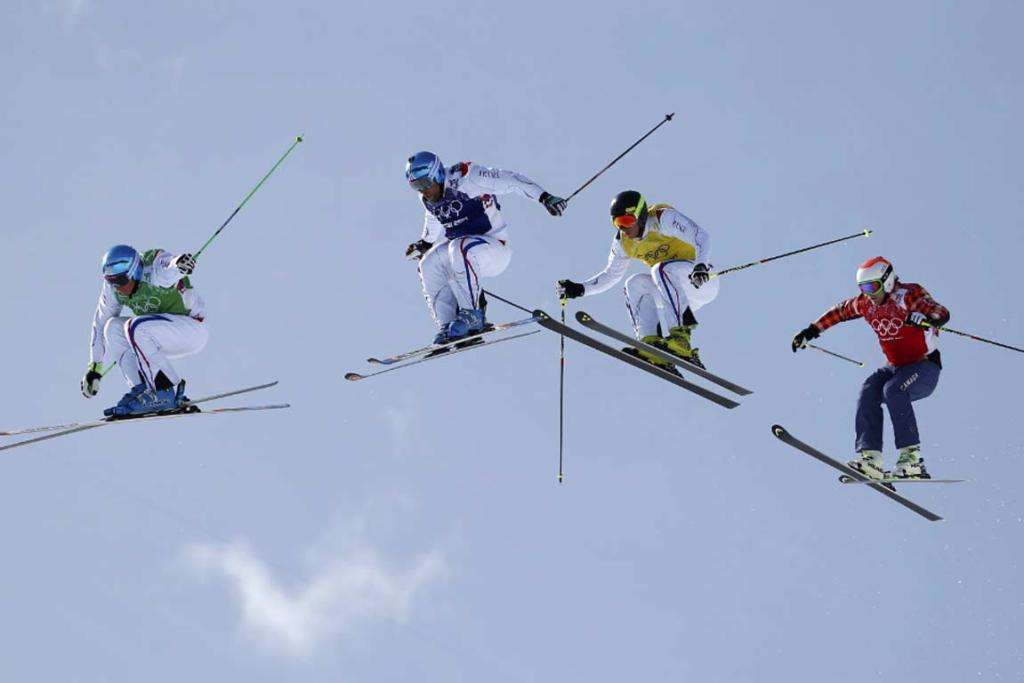 France's Jean Frederic Chapuis (left) leads compatriots Arnaud Bovolenta and Jonathan Midol and Canada's Brady Leman in the men's ski-cross final.