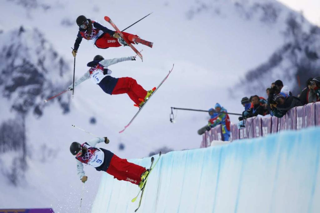 Annalisa Drew, Brita Sigourney (centre) and Maddie Bowman (top) practice during warm sessions ahead of the women's ski halfpipe qualification round.
