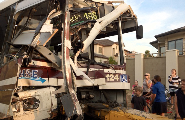 AFTERMATH: The remains of the bus following the crash that killed an elderly man.