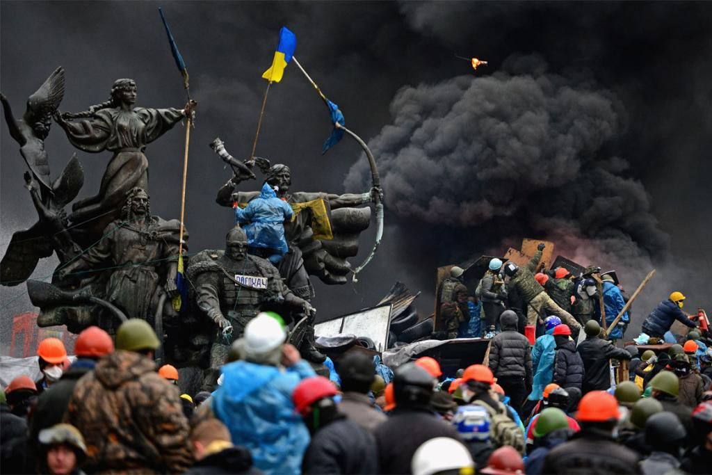 Anti-government protesters continue to clash with police in Independence square, Kiev.