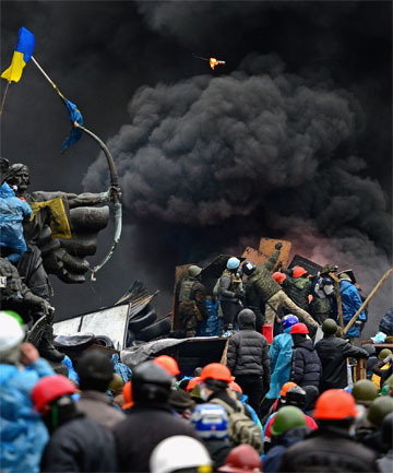 DAY OF VIOLENCE: Anti-government protesters continue to clash with police in Independence square, Kiev.