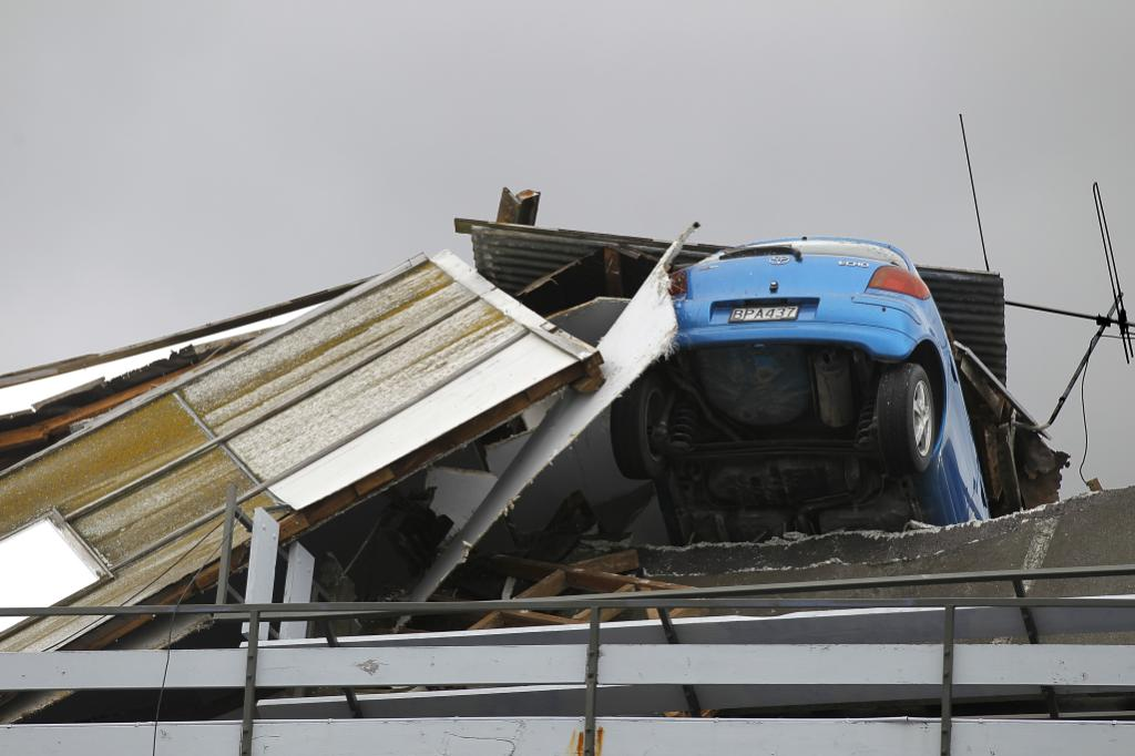 CAR PARK: A smashed car is seen in a car parking building on February 22, 2011 in Christchurch, New Zealand after a 6.3 magnitude earthquake.