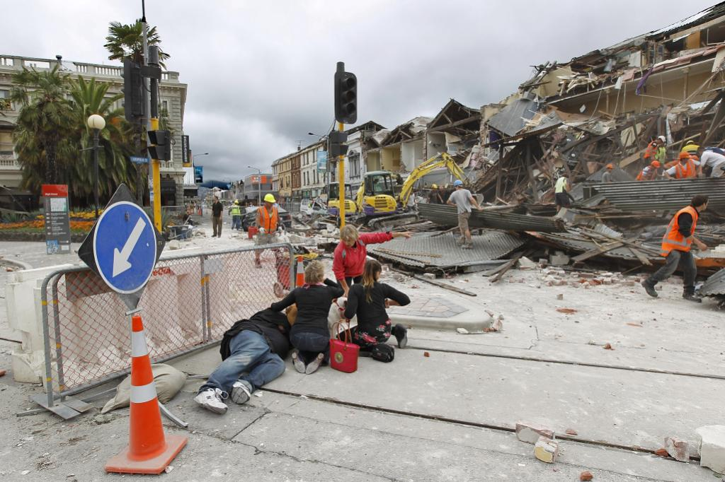 INJURED MAN: A man lies injured on Manchester Street on February 22, 2011 in Christchurch, New Zealand. The 6.3 magnitude earthquake - an aftershock of the 7.1 magnitude quake on September 4 - struck 20km southeast of Christchurch at around 1pm local time.