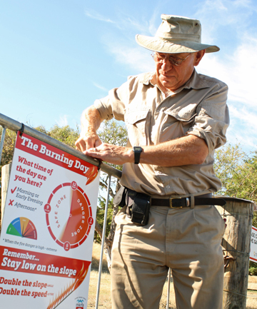 Ian Conway of the Marlborough Emergency Services support services puts up a sign an entrance to the Wither Hills Farm Park regarding high fire risks.