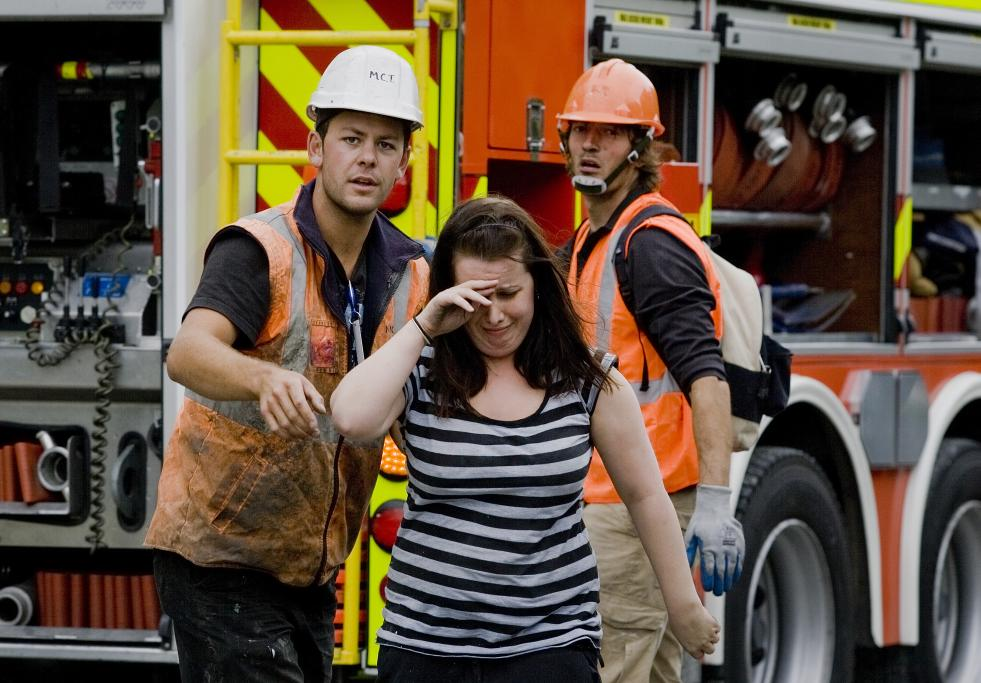 PGC: A woman after being rescued from the collapsed PGC building in Christchurch.