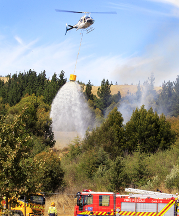 A Marlborough Helicopter with monsoon bucket assists Blenheim Volunteer Firefighters and The Rural Fire Force