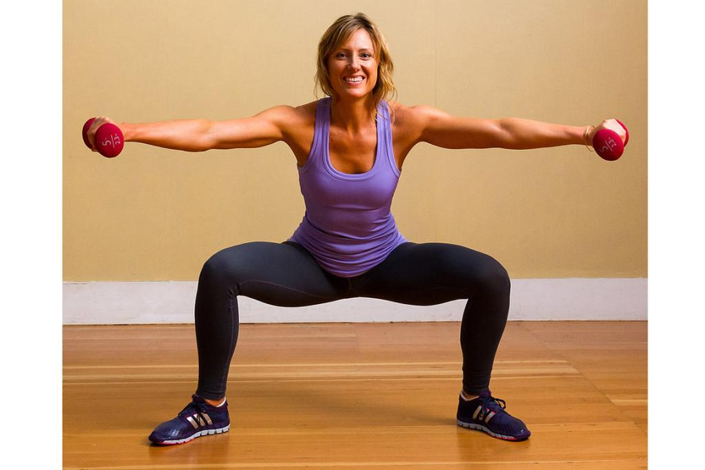 SUMO SQUAT WITH ARM RAISES: Celeb trainers David Kirsch, Jackie Warner, and Teddy Bass all recommend the sumo squat (also known by the feminine name plié squat) for creating shapely legs. Focus on the inner thigh when doing this move, not the quad. Stand with legs wide and toes pointed outward slightly. Hold a pair of dumbbells in your hands with your arms straight and your palms facing down. Bend your knees until your knees are over your ankles while raising your arms to just below shoulder height. Arms should be in line with your legs — you should see the weights in your peripheral vision. Straighten your legs and lower your arms simultaneously. Complete three sets of 15 reps.