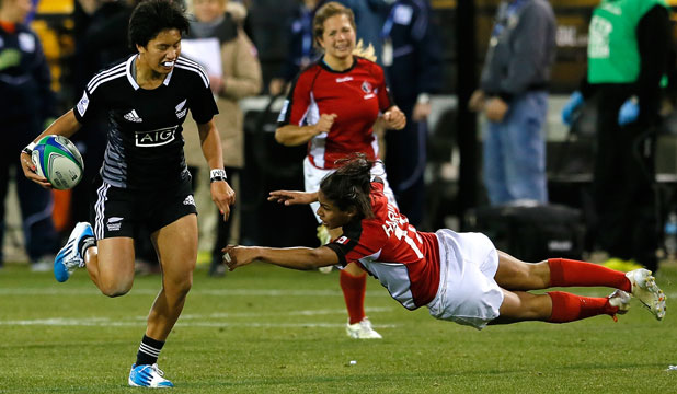 HARD RUNNING: Gayle Broughton breaks the tackle of Candian Magali Harvey at the Atlanta sevens event.