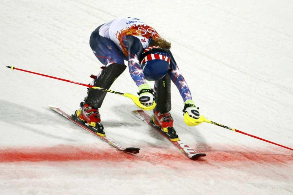American teen Mikaela Shiffrin crosses the line to win the women's slalom by 0.53 seconds.
