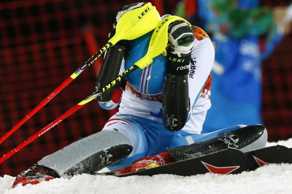 Austria's Bernadette Schild sits on the snow, with head in hands after crashing during her second run of the women's slalom.