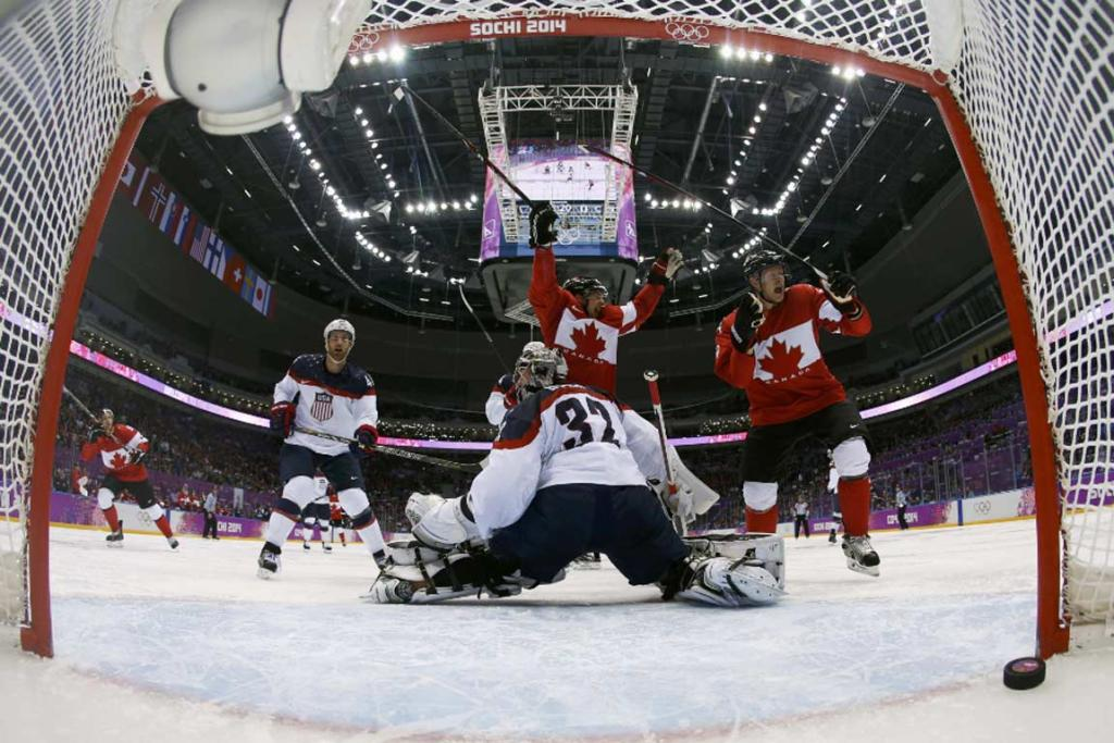 Canada's Jamie Benn (centre) celebrates his second period goal that proved the difference in the semifinal.