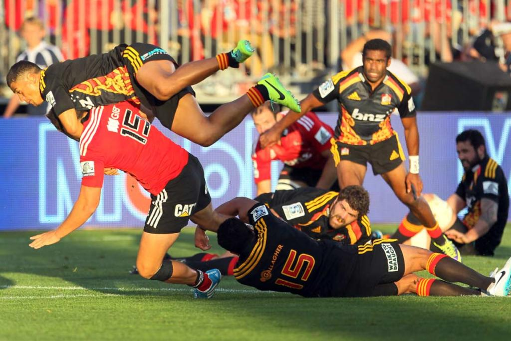 Chiefs players Charlie Ngatai and Mils Muliaina attempt to bring down Israel Dagg.