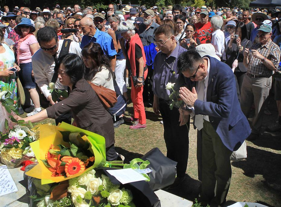 SERVICE: Public Memorial Service held in the Botanic Gardens on the third anniversary of the February 22nd 2011 Christchurch Earthquake. Families place flowers on the memorial after the service.