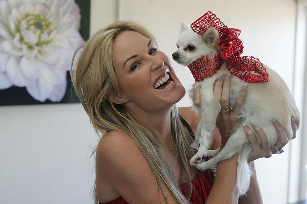 Charlotte Dawson, photographed in her Auckland home Dec. 2006. promoting a 2007 calendar which supports animals in need. She is holding her pet chihuahua dog Harper.